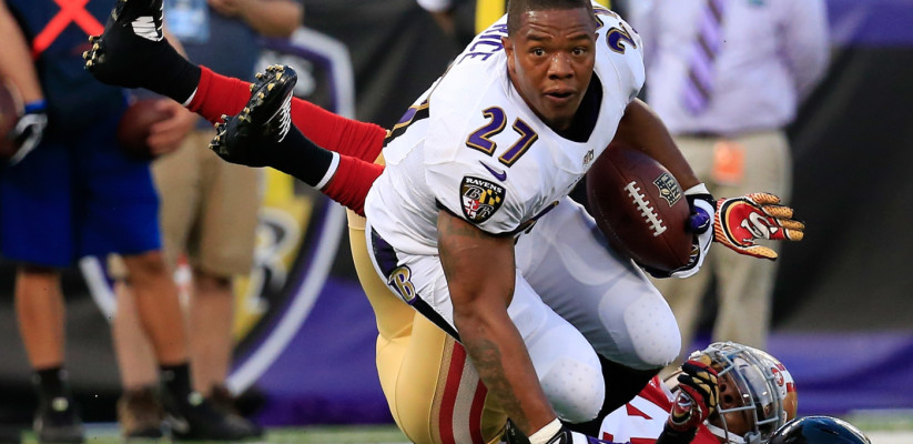 BALTIMORE, MD - AUGUST 07: Running back Ray Rice #27 of the Baltimore Ravens looses his helmet after being tackled by strong safety Antoine Bethea #24 of the San Francisco 49ers during the first half of an NFL pre-season game at M&T Bank Stadium on August 7, 2014 in Baltimore, Maryland.  (Photo by Rob Carr/Getty Images)